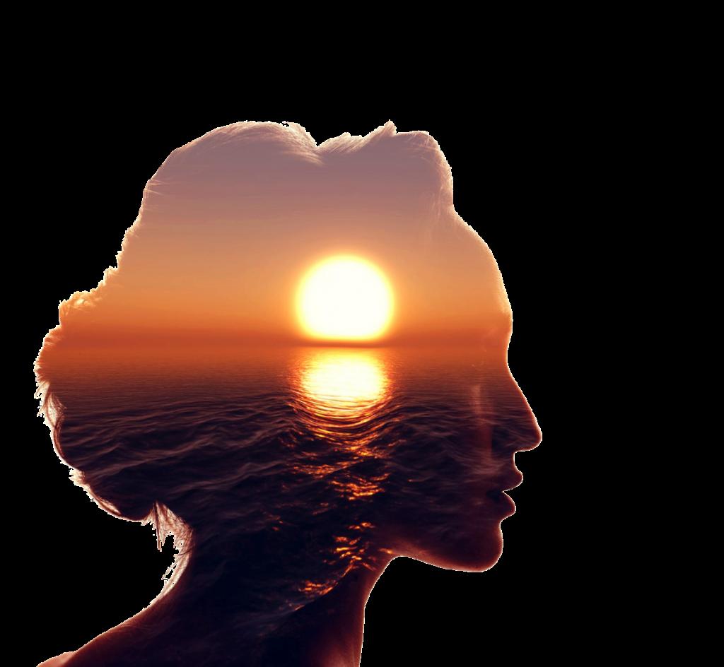 Konturen eines Frauenkopfes mit Sonnenuntergang am Meer